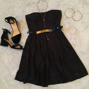 Strapless black floral dress.